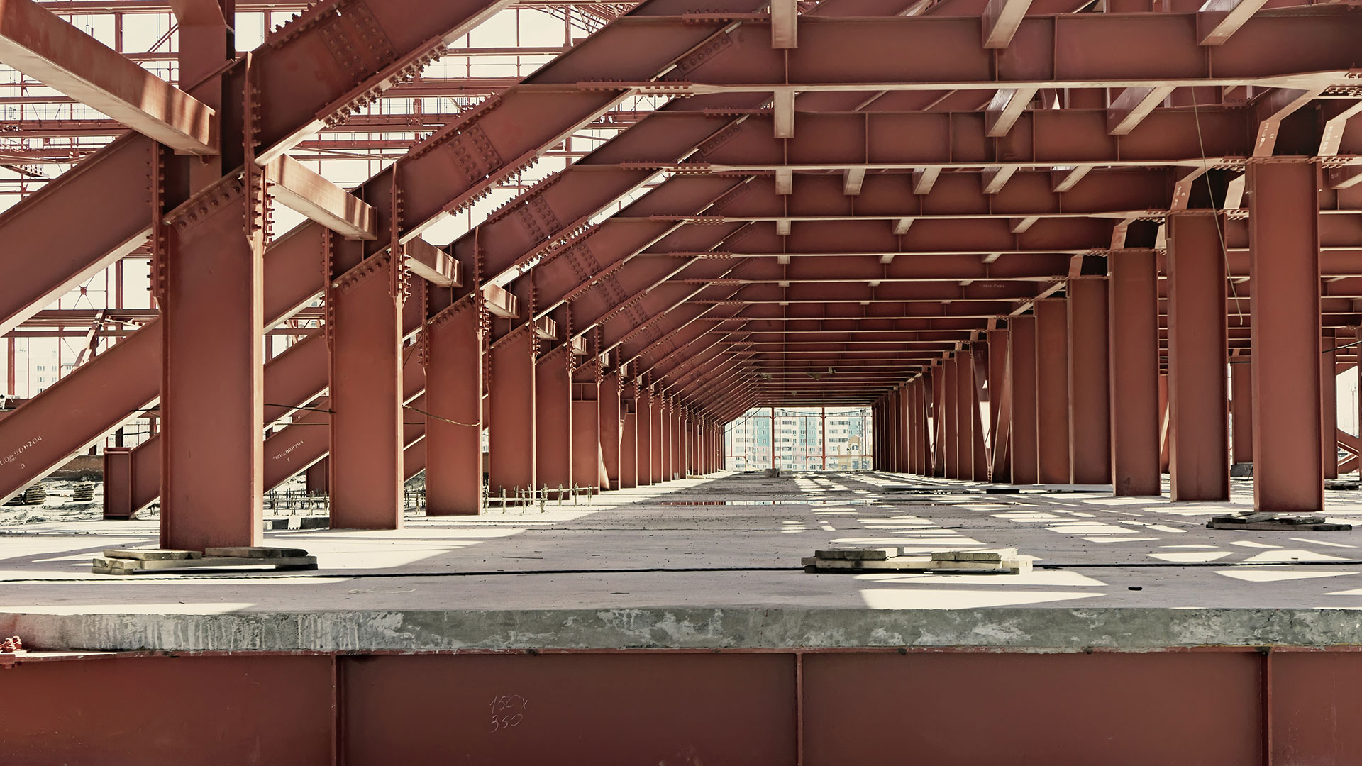 Hallway bridge of red steel girders