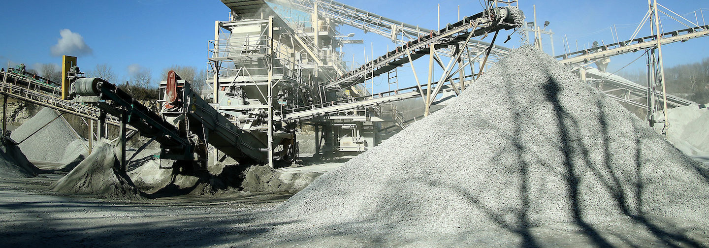 Great big pile of gravel near a set of conveyors